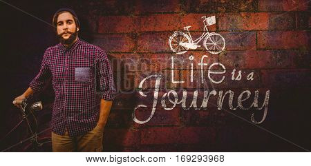 Portrait of confident hipster with bicycle against texture of bricks wall