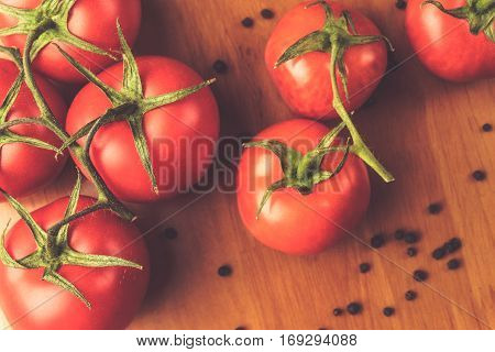 Top view of Fresh grape tomatoes with spices for use as cooking ingredients. Healthy eating.  copyspace