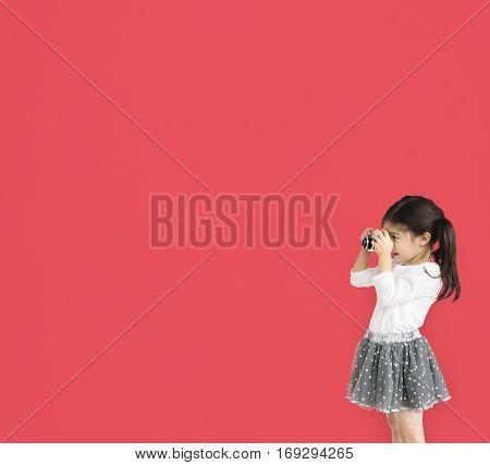 Little girl studio standing with binocular