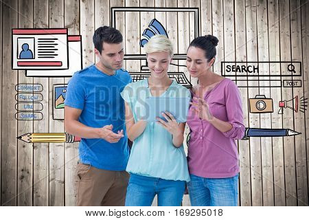 Group portrait of happy colleagues using tablet against wooden planks background