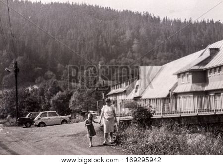 Vintage photo of woman and little girl in mountain resort (Poland, 1950's)