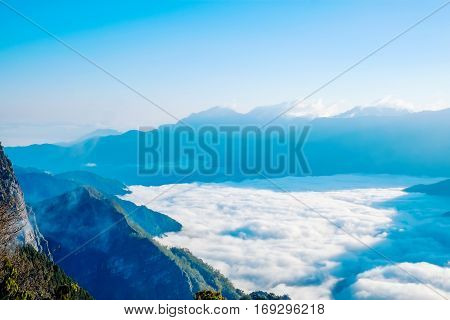 Beautiful morning sunrise dramatic cloud of sea giant rocks and Yushan mounatin under bright blue sky in Alishan(Ali mountain) National Park Taiwan