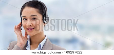 Portrait of a good looking operator posing with a headset against close up of swivel chair in an office
