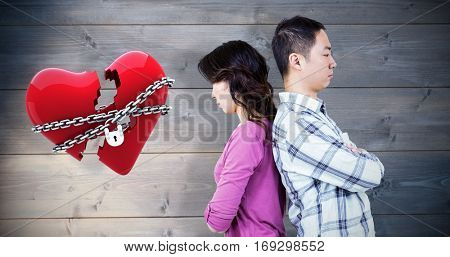 Annoyed couple with backs to each other against bleached wooden planks background
