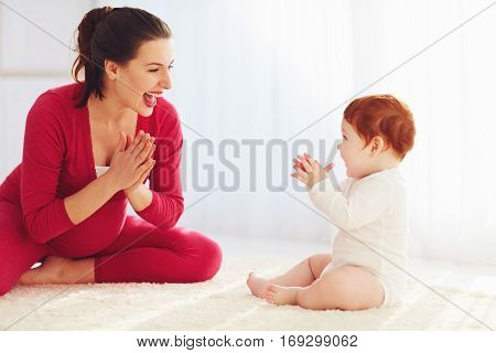 Happy Pregnant Mother And Toddler Baby Playing Games At Home, Clapping Hands Together