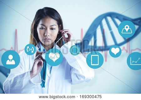 Asian doctor holding her stethoscope against blue medical background with dna and ecg
