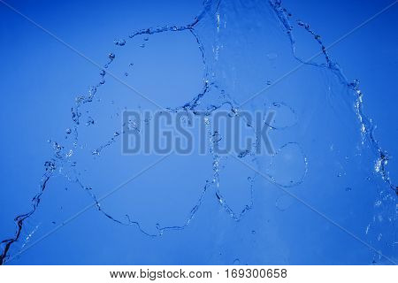 Texture of falling water on a blue background