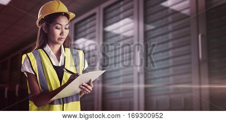 Architect woman with yellow helmet and plans against digitally generated server room with towers