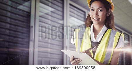 Architect woman with yellow helmet and plans against server room