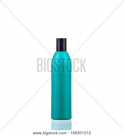 tubes of shampoo conditioner hair rinse mouthwash on a white background with reflection