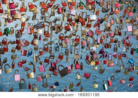 SALZBURG AUSTRIA - APRIL 29 2016: Close up of padlocks as a symbol of everlasting love at a bridge in Salzburg (Austria) over the river Salzach