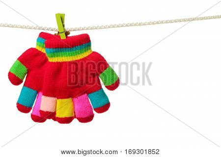 Multicolor striped gloves hanging on the clothesline on white background