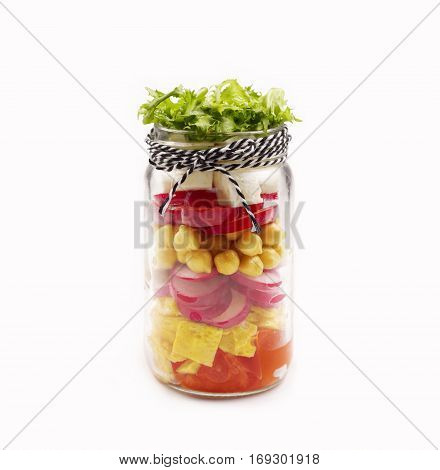 Salad in a jar isolated on white background. Healthy Homemade Mason Jar Salad. The concept of healthy proper nutrition for the whole family.