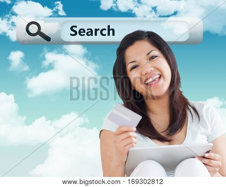 Woman laughs while she is holding a card and a tactile tablet against blue sky