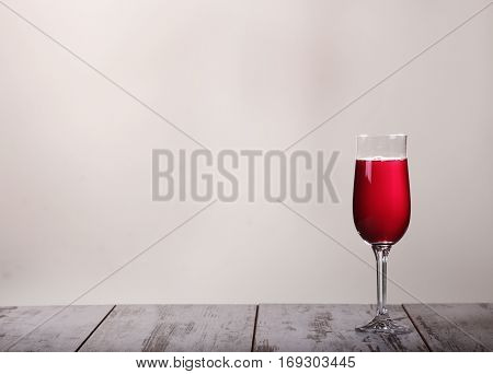 Still-life With The Rose Wine Glass And Bottle On Gray