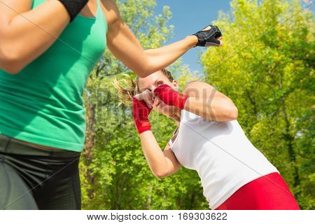 Two young women sparring focus on eye