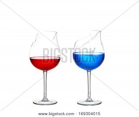 Two Broken Glasses With Red And Blue Cocktail On White Isolate