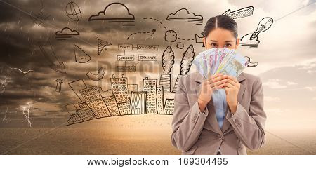 Portrait of a greedy businesswoman holding bank notes against ominous landscape