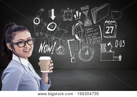 Businesswoman holding disposable cup and looking at wall with notes against black wall