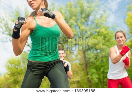 Tae Bo Training, toned image, outdoors, color image