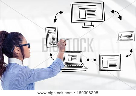 Businesswoman holding disposable cup and looking at wall with notes against responsive design doodle