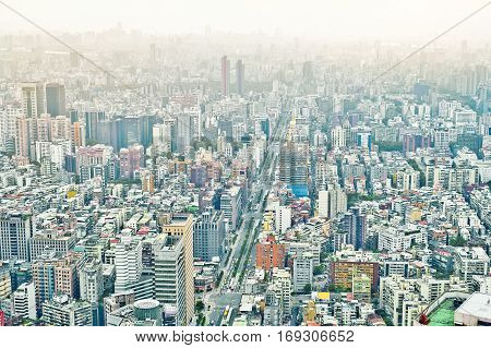 Business concept for real estate and corporate construction : panoramic modern city bird eye view with dramatic sunrise and morning blue sky from 101 building in Taipei Taiwan