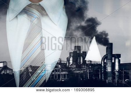 Double Exposure Smokestack In Factory Polution With Business Man , Business Man Factory Concept.