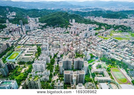 Business concept for real estate and corporate construction : panoramic modern city bird eye view with and morning cloudy blue sky from 101 building in Taipei Taiwan