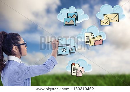 Businesswoman holding disposable cup and looking at wall with notes against green grass under blue sky