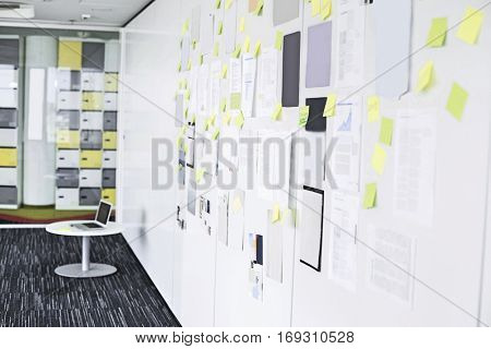 Sticky notepapers on wall in creative office space