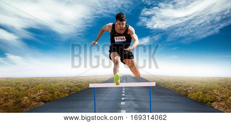 Sportsman practising hurdles against view of an empty street