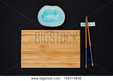 A stillife with copsticks and bamboo board