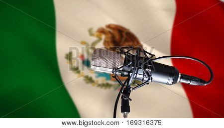 Condenser microphone against digitally generated mexican national flag
