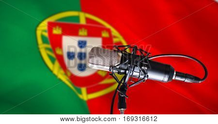 Condenser microphone against digitally generated portugese national flag