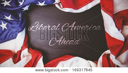 liberal america ahead against american flag on chalkboard