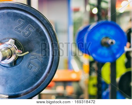 Barbell ready to workout in gym. Shallow DOF. Copy space. Sport or powerlifting background.