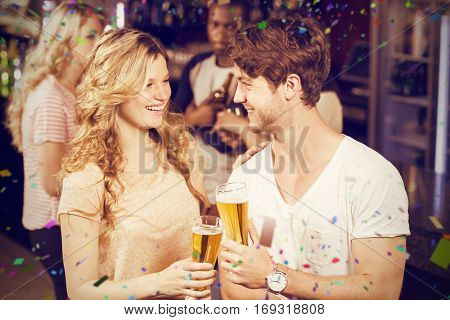 Friends toasting with beer against flying colours