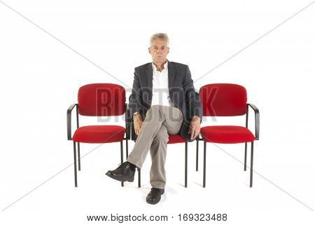 Man sitting in waiting room isolated over white background