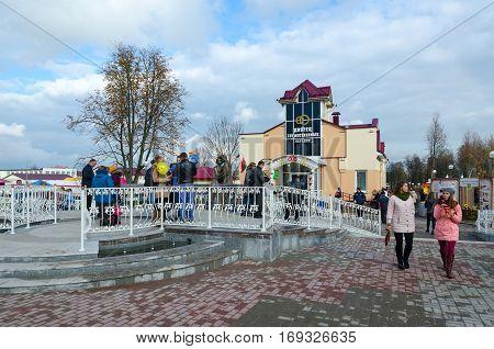 SENNO BELARUS - OCTOBER 8 2016: Unidentified people walk on town square near new building of Civil Registry Office during festival-fair Dozhinki 2016 in Senno Vitebsk region Belarus