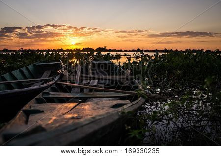 Fishermen's boats in Puerto Pollo at Rio Paraguay in Paraguay's Pantanal at sunset