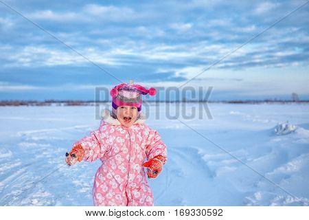 Portrait Of Little Cute Happy Baby Girl, Walk In Winter Snow Park,
