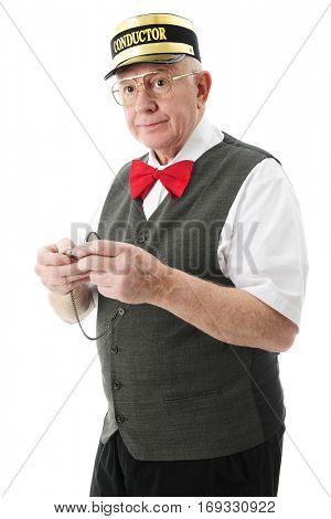 A senior train conductor holding his pocket watch.  On a white background.