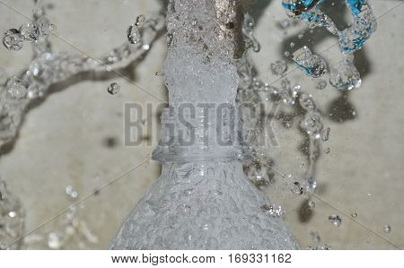 water splash from faucet to the bottlenose