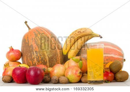 Autumn nature fruits concept. Fall fruits and orange juice, on a white background, studio picture