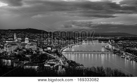 Aerial view of Budapest Hungary with clouds. Buda castle Chain bridge and Parliament building. Black and white