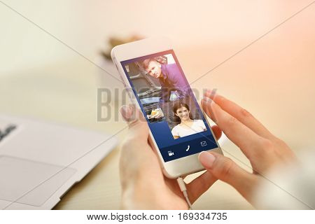 Woman video conferencing on smartphone. Online car service concept.