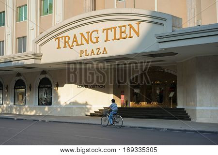 Hanoi, Vietnam - Sep 14, 2014: People moving on street by Trang Tien plaza on Hang Bai street. The plaza is an iconic landmark set at the corner of Hoan Kiem Lake right in the city centre