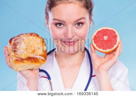 Dietitian With Sweet Roll Bun And Grapefruit.