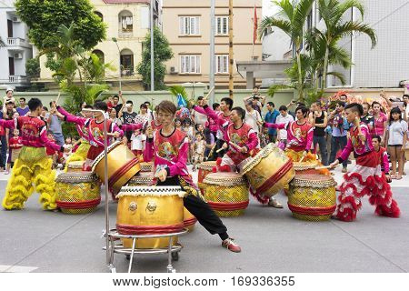 Hanoi, Vietnam - Sept 8, 2014: A show of dragon and lion dance performed at lunar mid autumn festival at Times City Complex. This is a form of traditional dance and performance in Vietnamese culture