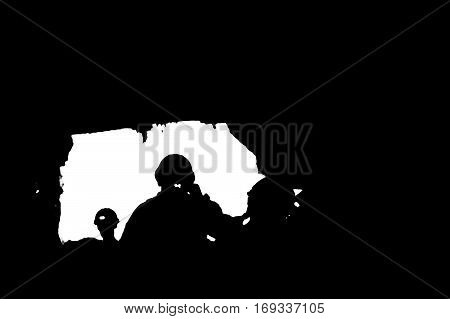 Silhouette of Miners with headlamp in cave